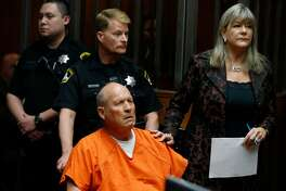 Joseph DeAngelo appears in a Sacramento County courtroom with his public defender Diane Howard for his arraignment on multiple rape and murder charges in Sacramento, Calif. on Friday, April 27, 2018. Authorities believe DeAngelo is the East Area Rapist and Golden State Killer who committed numerous crimes from 1976 to 1986.