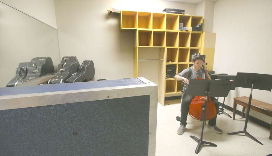 John Jay High School student Aleks (cq) Bass,16, practices his instrument Thursday April 19, 2018 in a small room at the school's fine arts building. Northside School District is having its largest bond proposal in its history to be held on May 5. The almost $850 million proposal will help update or rebuild the school's fine arts building at a cost of about $47 million. Photo: John Davenport, Ond Proposal / San Antonio Express-News / ©John Davenport/San Antonio Express-News