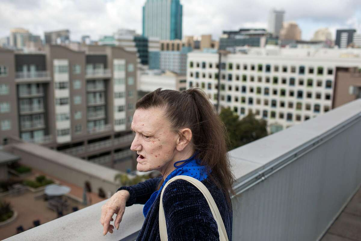 """Cindy """"Brandy"""" Werling, 52, lives in an apartment building that provides their residents with access to a rooftop which Cindy often takes advantage of. Last fall, for the first time in decades, Cindy moved out of supportive housing into her very own apartment, thanks to a HUD rent voucher."""