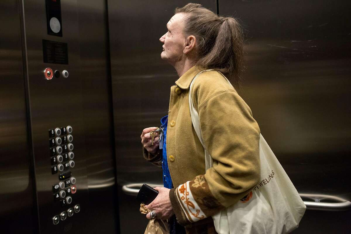 """Cindy """"Brandy"""" Werling, 52, takes the elevator up to her apartment on Harrison Street in San Francisco."""