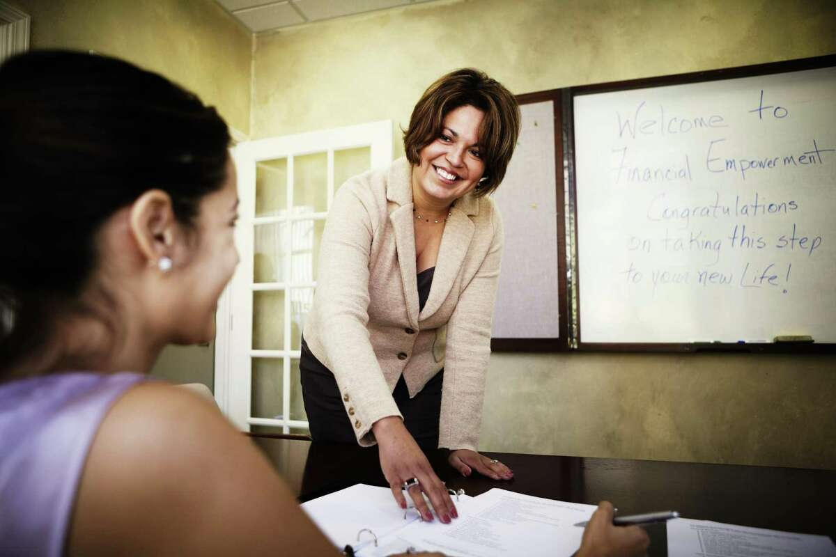An Allstate agent teaches the Purple Purse curriculum to an abuse survivor.