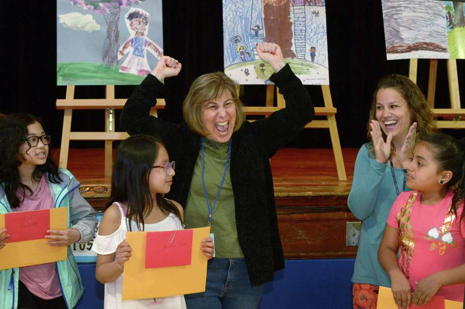 Third grade teacher Michelle Klein celebrates winning a free night stay at Double Tree Hotel while Arbor Day Poster Winners, 4th grader Natalie Erfe, 3rd grader Lindsay Tacuri, 2nd grade teacher Claire Mickolyczk, and 2nd grade winner Samantha Bautista look on as Tracey Elementary School hosts the Norwalk Arbor Day Celebration Friday, April 27, 2018, in Norwalk, Conn. Photo: Erik Trautmann / Hearst Connecticut Media / Norwalk Hour