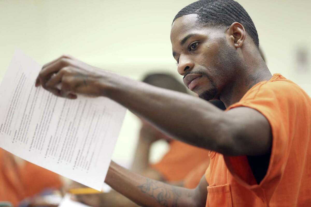 Bexar County Jail inmate Marquez Jackson looks at resume writing tips April 18, 2018 during an Alamo Colleges-sponsored class in the jail. The Alamo Colleges have been offering vocational classes in the facility four four years.