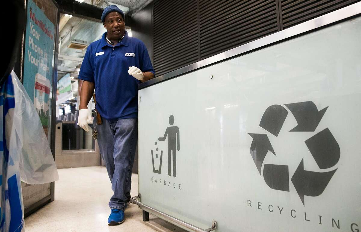 20-year Bart System Service worker Charles Golsby inspects trash and recycling cans inside the Powell Street Bart Station Thursday, April 12, 2018 in San Francisco, Calif.