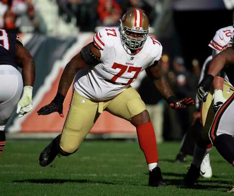 e5aed1eaaf1 San Francisco 49ers offensive tackle Trent Brown (77) sets to block against  the Chicago