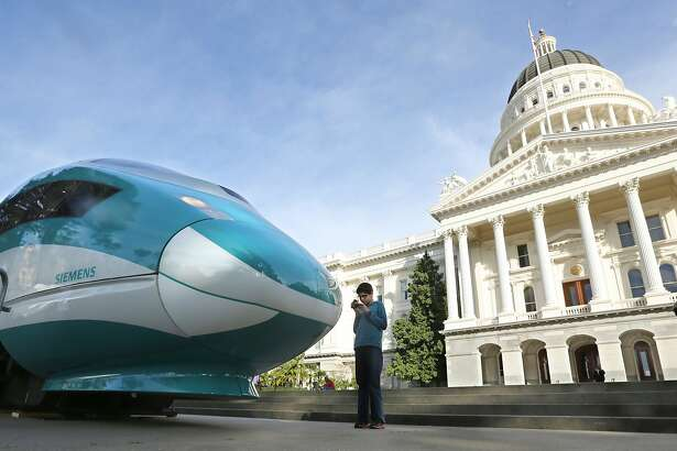 In this 2015 photo, a full-scale mock-up of a high-speed train is displayed at the Capitol in Sacramento. A group proposing to repeal a hike in the state's gas tax has proposed a ballot initiative for 2020 that would kill a planned high-speed train in California. (AP Photo/Rich Pedroncelli, File)