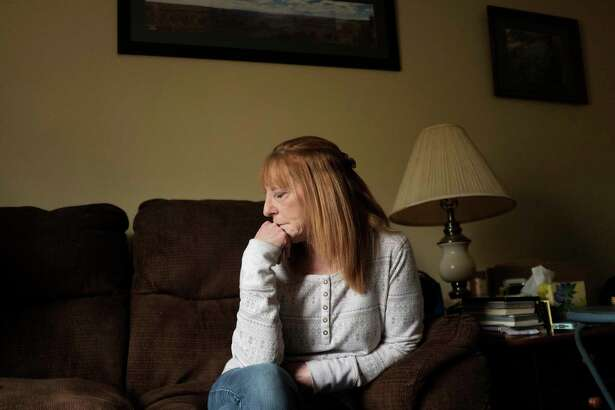 Julie Roy pauses as she recounts the day her son, William Timber, died of a drug overdose, during an interview at her home on Wednesday, April 18, 2018, in Poestenkill, N.Y.  (Paul Buckowski/Times Union)