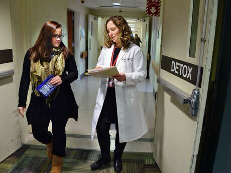 Dr. Melissa Weimer, right, consults with outreach specialist Megan Mulholland in the new ambulatory detox program at St. Peters Hospital Thursday Feb. 1, 2018 in Albany, NY.  (John Carl D'Annibale/Times Union) Photo: John Carl D'Annibale / 20042799A