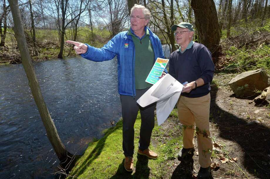 Norwalk River ValleyTrail Executive Director CharlieTaney and NRVT Norwalk Representative Jim Carter point out the future trail section of the NRVT along the Norwalk River Thursday, April 26, 2018, in Norwalk, Conn. The long-planned mile-long stretch of the NRVT between Union Park and New Canaan Avenue could get constructed this coming winter after the Norwalk Conservation Commission gave its blessing to the proposal Tuesday evening. The Norwalk Department of Public Works hopes to put the largely federally funded $3 million project out to bid later this year. Photo: Erik Trautmann / Hearst Connecticut Media / Norwalk Hour