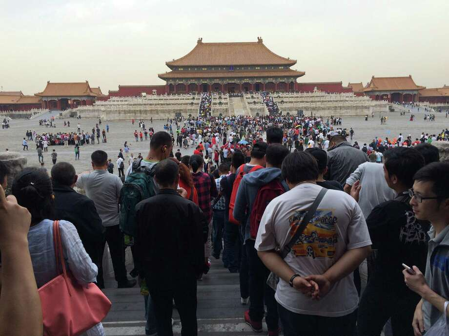A crowd of tourists visits the Forbidden City in Beijing, China. Photo: Thomas Huang, MBR / TNS / Dallas Morning News