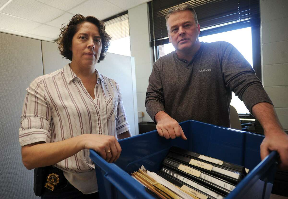 Fairfield Detective Kerry Dalling, left, and Lieutenant Michael Gagner with some of their research into the 1986 case of a murdered baby found at Lake Mohegan at the Fairfield Police Station in Fairfield, Conn. on Monday, April 23, 2018.