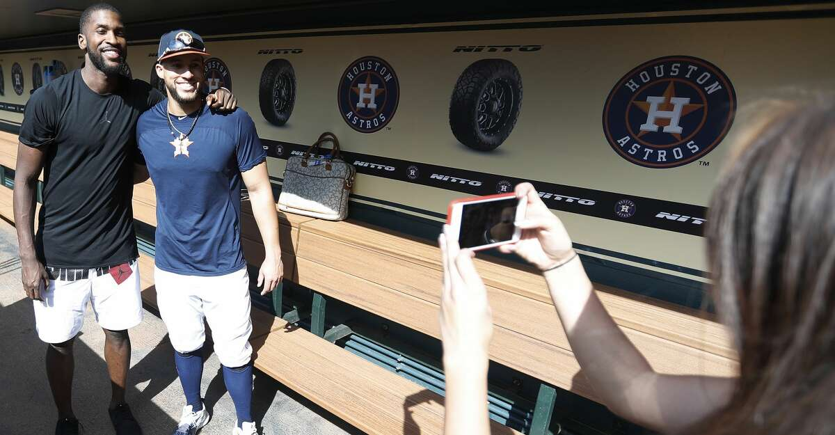 Houston Astros George Springer gets his photo taken with Michael Kidd-Gilchrist in the dugout during batting practice before the start of an MLB game at Minute Maid Park, Friday, April 27, 2018, in Houston. Kidd-Gilchrist and Springer are both professional athletes with studders, who finally connected today. ( Karen Warren / Houston Chronicle )