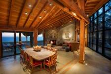 The 3,180-square-foot custom retreat features a gourmet kitchen, a media room, office, wine cellar, and Jacuzzi, surrounded by an oak forest and a meadow.