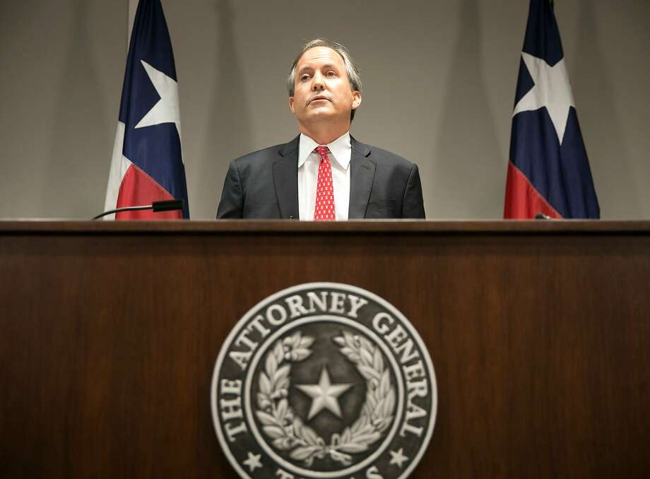 Attorney General Ken Paxton, as promised, announced a multi-state  lawsuit Tuesday to end the program that protects certain undocumented  immigrants brought to this country as children. Photo: Jay Janner, Associated Press