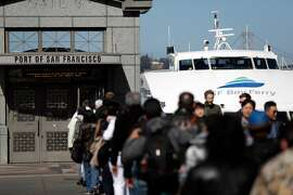 Passengers line up to board the ferry to Vallejo from the Ferry Building, in San Francisco, Calif., on Thursday, April 26, 2018. Commuting by ferry remains popular and often crowded during heavy commute hours.