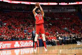 NEW ORLEANS, LA - APRIL 21:  Anthony Davis #23 of the New Orleans Pelicans takes a three point shot against the Portland Trail Blazers during the second half of Game Four of the first round of the Western Conference playoffs at the Smoothie King Center on April 21, 2018 in New Orleans, Louisiana.  The Pelicans defeated the Trail Blazers 131-123 to sweep the series 4-0.  NOTE TO USER: User expressly acknowledges and agrees that, by downloading and or using this photograph, User is consenting to the terms and conditions of the Getty Images License Agreement.  (Photo by Stacy Revere/Getty Images)