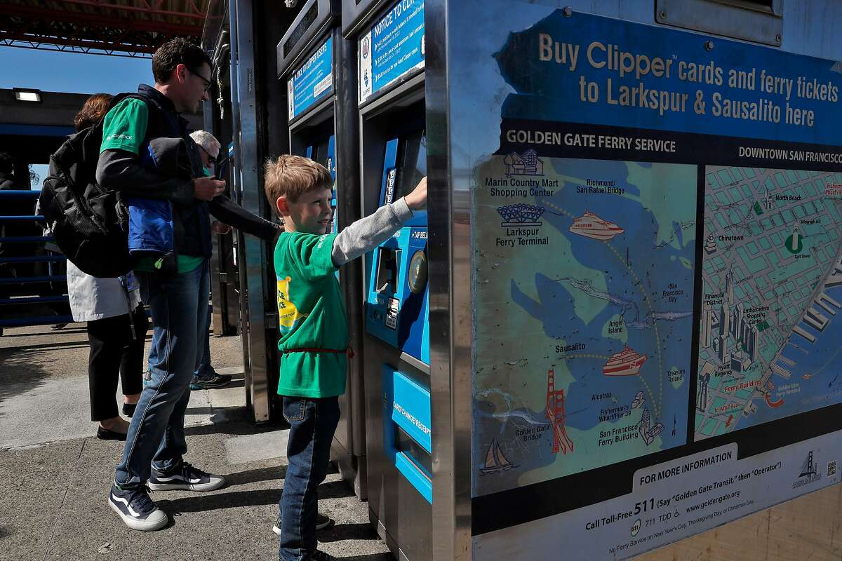 Craig McKinlay and his son Cullan, 7, get tickets for the ferry to Larkspur from the Ferry Building, in San Francisco, Calif., on Thursday, April 26, 2018. Commuting by ferry remains popular and often crowded during heavy commute hours.