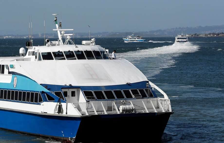 A ferry to Larkspur (front) departs as others make their way to Sausalito and Vallejo from the Ferry Building. Photo: Carlos Avila Gonzalez / The Chronicle