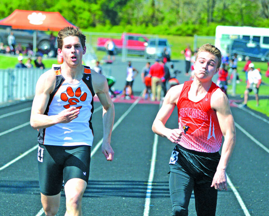 Edwardsville senior Ben Ryan, left, competes in the 100-meter dash on Friday during the second annual Knight Invitational at Triad.
