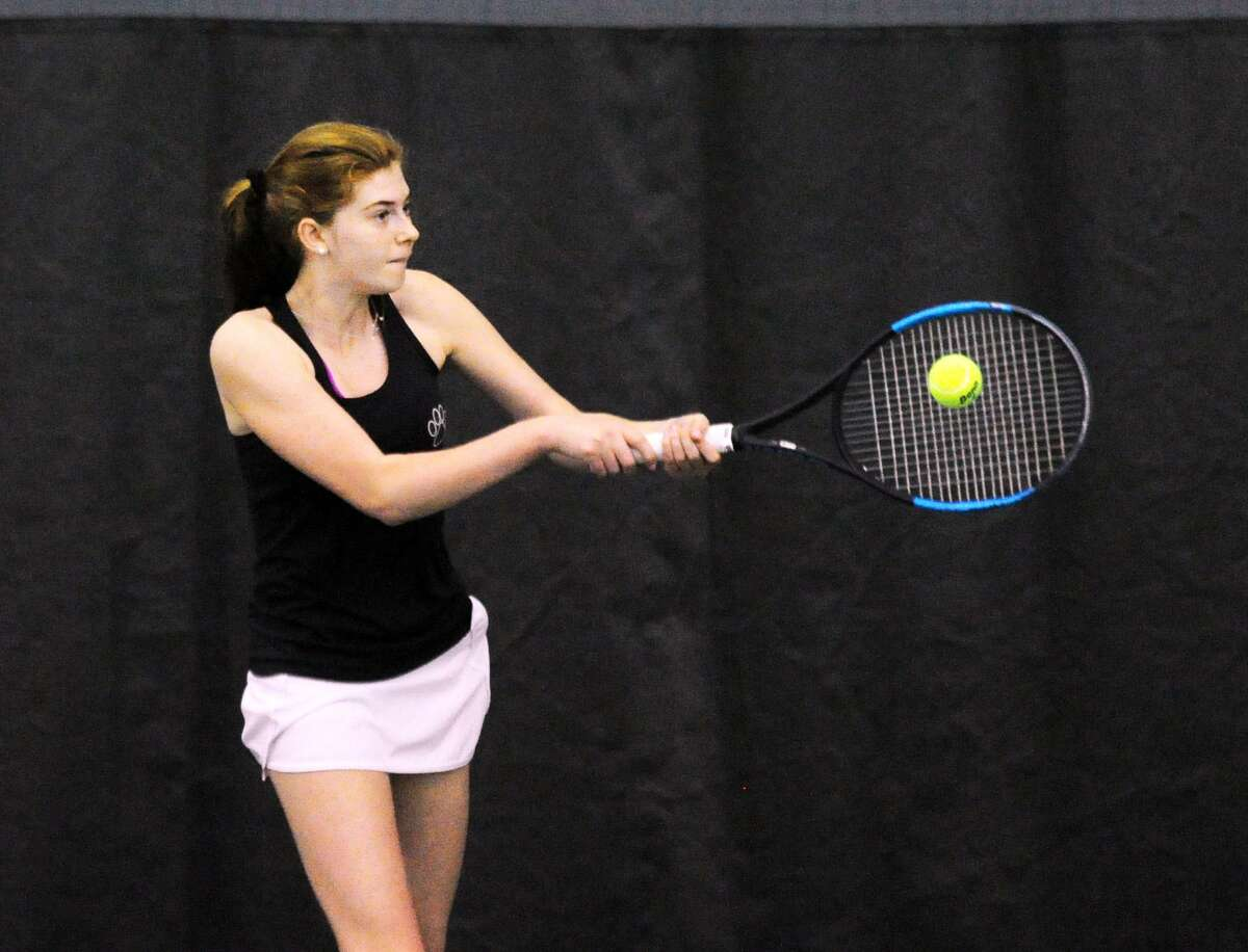 Sacred Heart's Grace Coale takes a swing in her match against Greenwich Academy's Emma Carney on Friday.