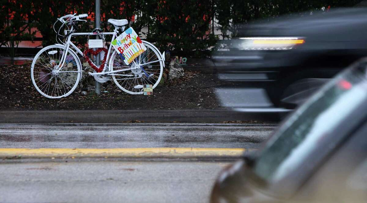 A ghost bike stands near the location where bike rider Chelsea Norman lost her life at Waugh and West Gray in Houston on Jan. 23, 2014.