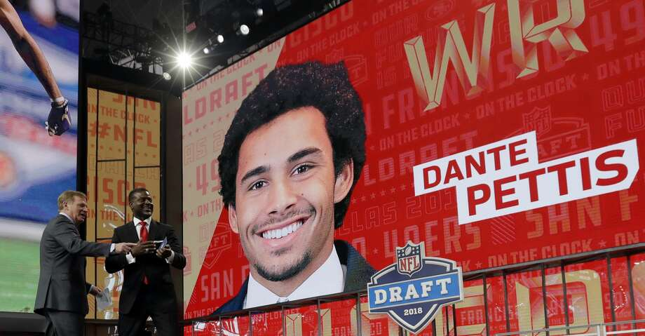 NFL Commissioner Roger Goodell, left, and former player Merton Hanks walk off the stage after announcing Washington's Dante Pettis as the San Francisco 49ers' pick during the second round of the NFL football draft Friday, April 27, 2018, in Arlington, Texas. (AP Photo/Eric Gay) Photo: Eric Gay/Associated Press