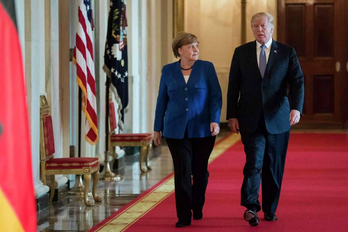 President Donald Trump arrives with German Chancellor Angela Merkel on Friday for a joint news conference in the East Room of the White House.