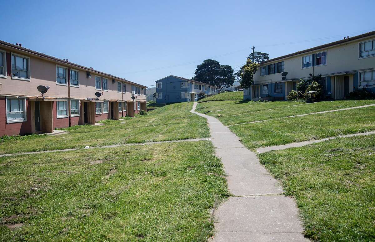 Rows of public housing units are seen surrounded by a manicured lawn Wednesday, April 25, 2018 in the Sunnydale neighborhood of San Francisco, Calif.