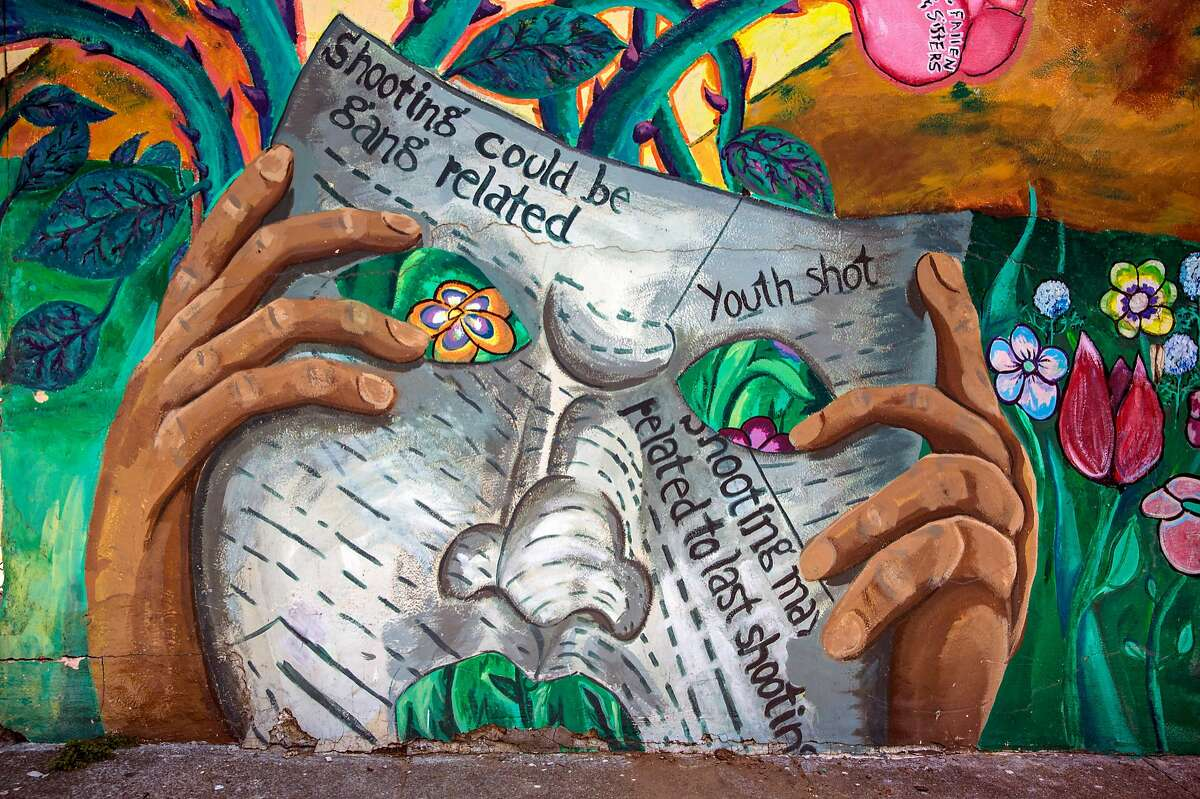 A mural created in 2004 on the wall of Little Village Market hints at the frequency of gang violence Wednesday, April 25, 2018 in the Sunnydale neighborhood of San Francisco, Calif.