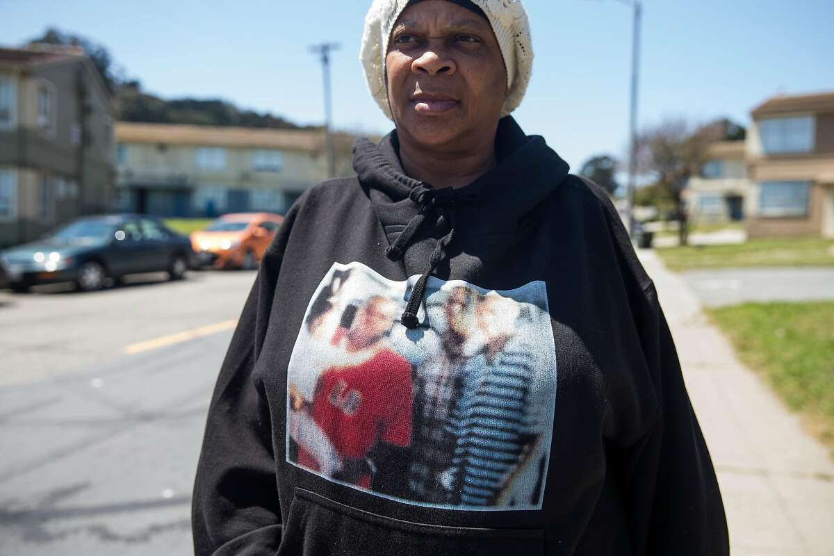 Carla Ellis, 58, walks down Sunnydale Avenue while wearing a sweatshirt memorializing her son who was killed at the hand of gang violence in Richmond, Calif. in 2004 seen Wednesday, April 25, 2018 in the Sunnydale neighborhood of San Francisco, Calif.