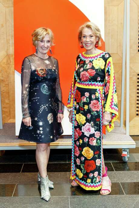 SFMOMA Modern Ball co-chairs Nancy Bechtle and Charlotte Shultz stand in front of the Ellsworth Kelly painting that was auctioned. Photo: Drew Altizer Photography / Special To The Chronicle