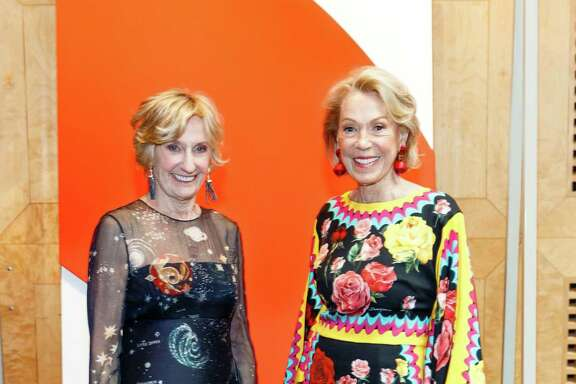 SFMOMA Modern Ball co-chairs Nancy Bechtle and Charlotte Shultz stand in front of the Ellsworth Kelly painting that was auctioned.