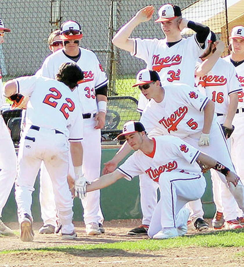Edwardsville's Collin Elvers (22) is greeted by teammates outside the dugout after hitting a three-run homer in the second inning Friday in his team's 9-5 victory over Civic Memorial at Tom Pile Field in Edwardsville. Photo:     Greg Shashack | The Telegraph