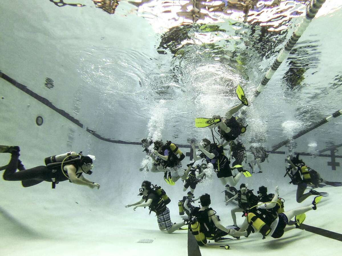Students with the Sussex Air Cadets, in England, and Les Maristes Toulouse, in France, train to SCUBA dive during a session of Space Center University on Thursday, April 12, 2018, in Houston. Space Center U is a challenging five-day program offered year-round to students so they can experience what training to be an astronaut might be like. ( Brett Coomer / Houston Chronicle )