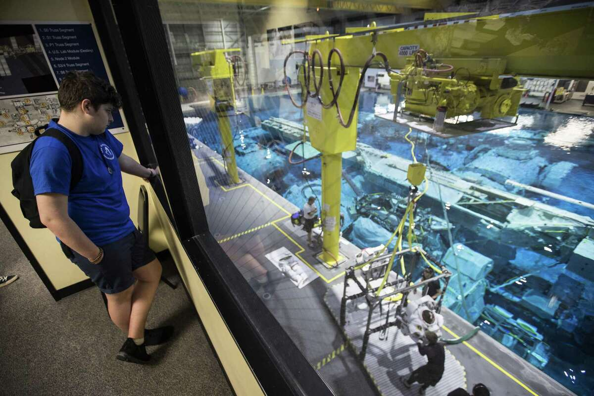 Baptest Eneu, from Les Maristes Toulouse in France, observes the training at NASA's Neutral Bouyancy Laboratory during a session of Space Center University on Thursday, April 12, 2018, in Houston. Space Center U is a challenging five-day program offered year-round to students so they can experience what training to be an astronaut might be like. ( Brett Coomer / Houston Chronicle )