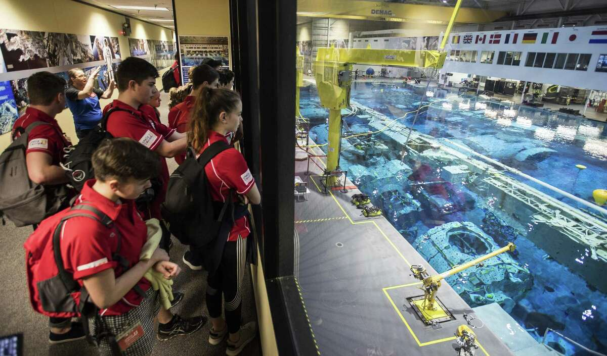 Sussex Air Cadets watch the training in NASA's Neutral Buoyancy Laboratory during a session of Space Center University on Thursday, April 12, 2018, in Houston. Space Center U is a challenging five-day program offered year-round to students so they can experience what training to be an astronaut might be like. ( Brett Coomer / Houston Chronicle )