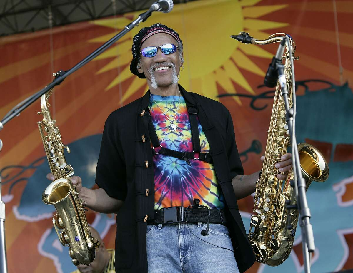 FILE - In a May 4, 2008 file photo, Charles Neville arrives with The Neville Brothers on stage to perform during the 2008 New Orleans Jazz & Heritage Festival at the New Orleans Fairgrounds Racetrack in New Orleans. New Orleans-born saxophone player Charles Neville has died at age 79. A publicist for Aaron Neville�s management agency confirmed the death in an email. (AP Photo/Dave Martin, File)