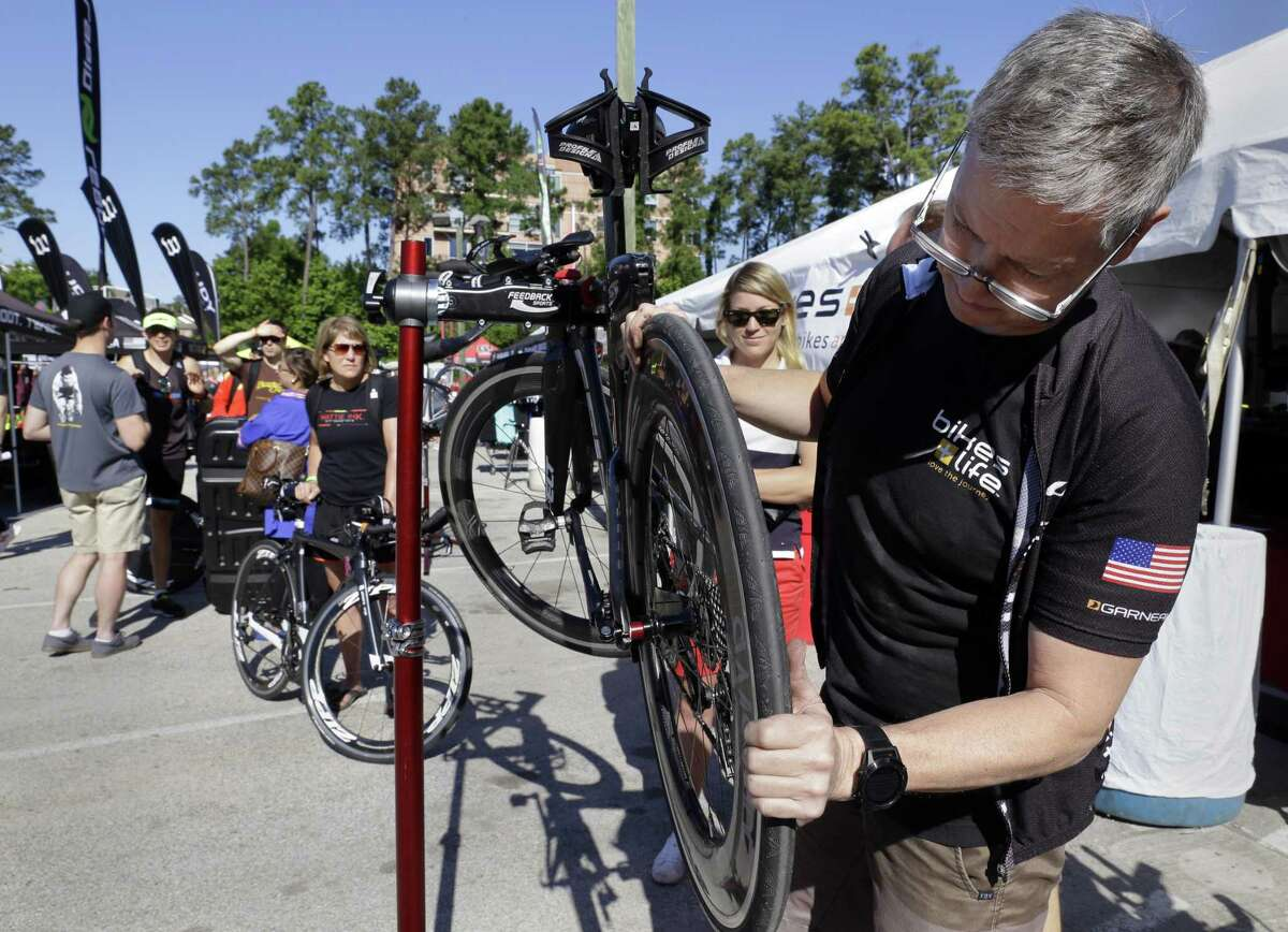 John Antretter, a bike mechanic, checks over bikes for athletes during check in day Thursday, April 26, 2018, for the Memorial Hermann Ironman North American Championship Thursday, April 26, 2018, in The Woodlands, TX. The event will be held Saturday April 28, 2018. (Michael Wyke / For the Chronicle)