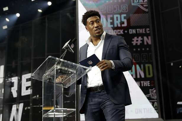 Former Raiders player Bruce Irvin announces North Carolina's Brandon Parker as the Oakland Raiders' selection during the third round of the NFL football draft Friday, April 27, 2018, in Arlington, Texas. (AP Photo/Eric Gay)