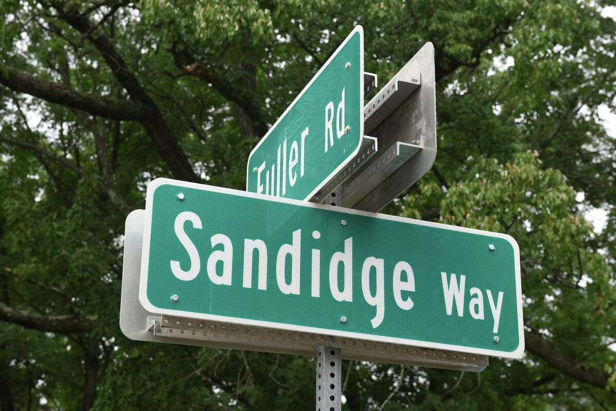 Famliy members and dignitaries take part in a renaming ceremony on Loughlin Street to Sandidge Way named after the first African-American family to purchase a home on the street on Saturday July 30, 2016 in Albany, N.Y. (Michael P. Farrell/Times Union)