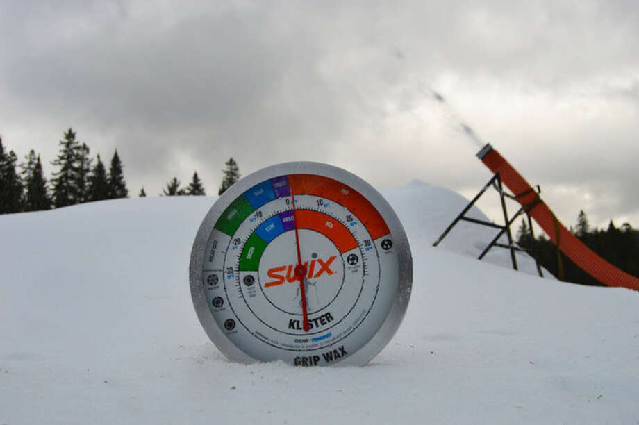 Snow is blown out of a tube connected to the Snow Factory, an Italian-made artificial snow machine that helped the Mt. Van Hoevenberg cross-country ski center in the Adirondacks set a record season of 157 days this winter. (Mt. Van Hoevenberg ski center)