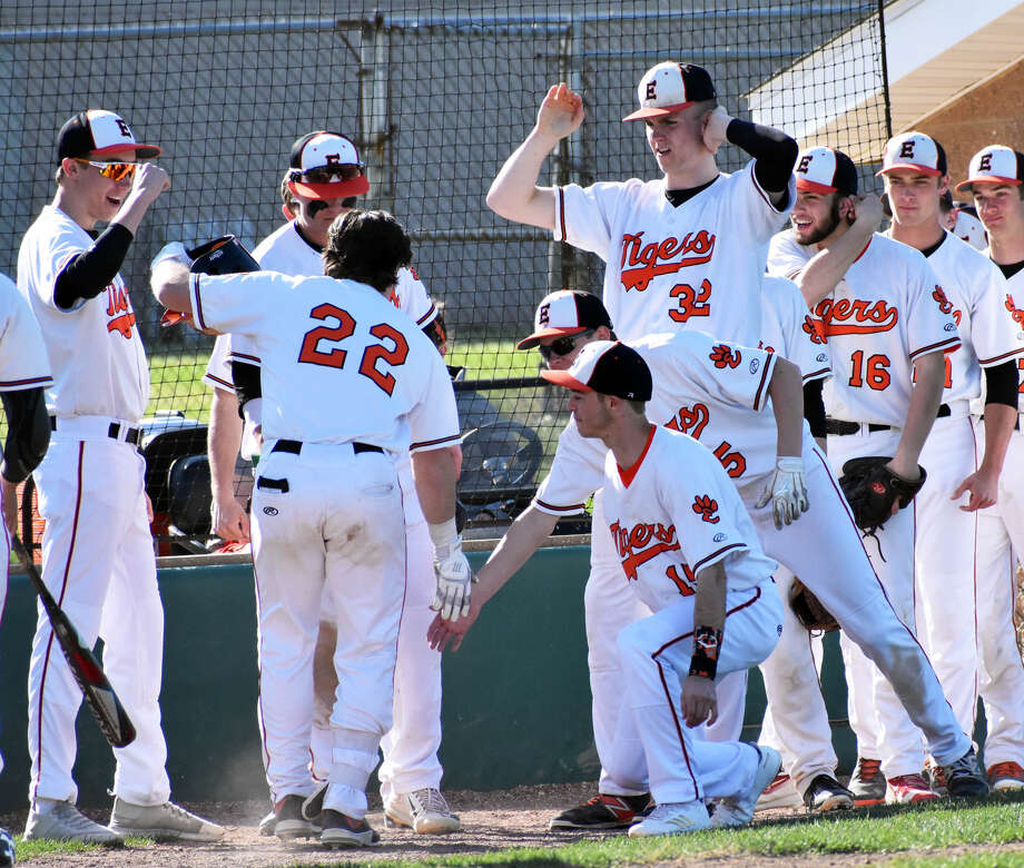 Edwardsville celebrates after a three-run home run hit by Collin Elvers (No. 22) in the third inning for the Tigers against Civic Memorial.
