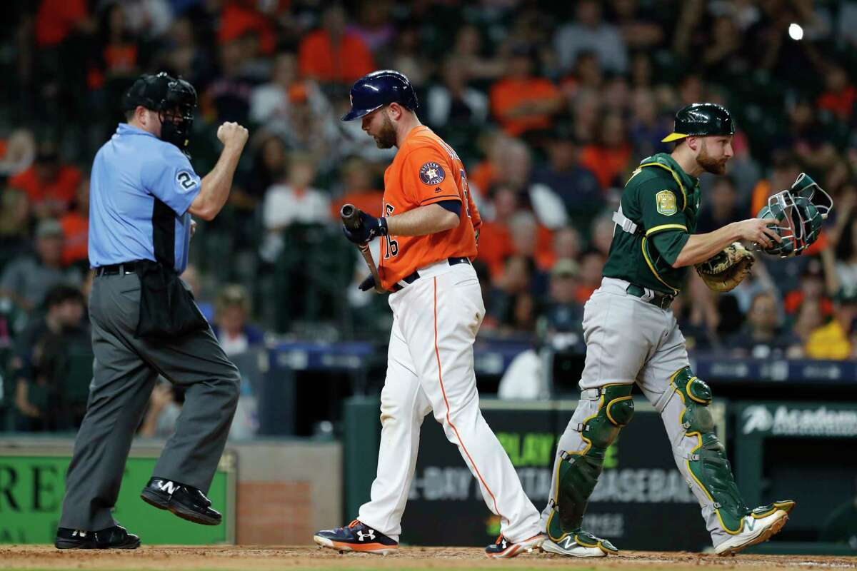 Houston Astros catcher Brian McCann (16) reacts after striking out to end the game as the Astros lose 8-1 after an MLB game at Minute Maid Park, Friday, April 27, 2018, in Houston.