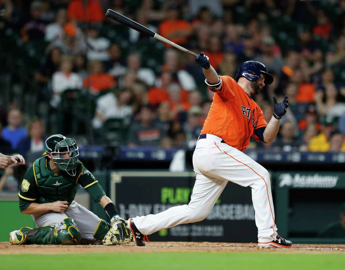 Houston Astros catcher Brian McCann (16) strikes out to end the game as the Astros lose 8-1 after an MLB game at Minute Maid Park, Friday, April 27, 2018, in Houston.
