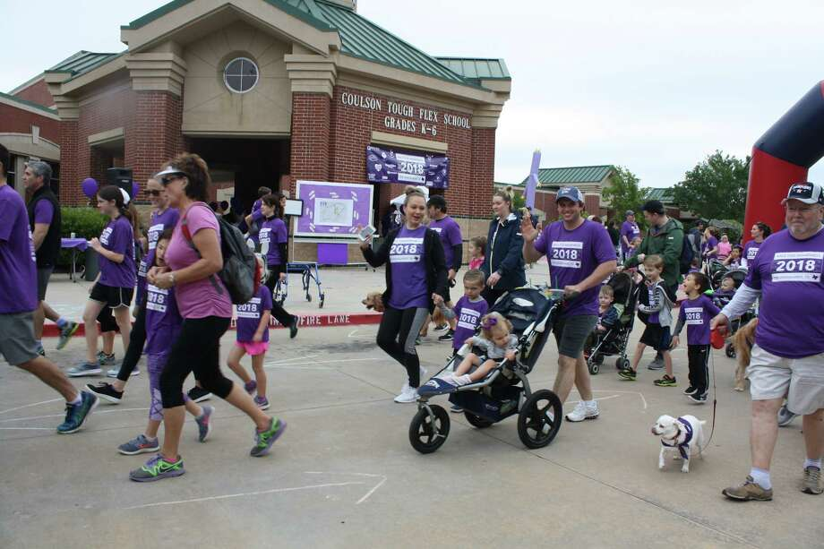 "More than 1,000 participants converged on the school's campus in The Woodlands April 21 to ""purple out,"" donning purple shirts and even purple hair and makeup - all to raise money for The Periwinkle Foundation. Photo: Coulson Tough Elementary"