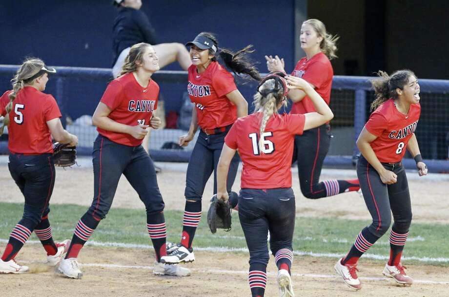 Members of the New Braunfels Canyon Cougarettes celebrate their 6-4 win in eight innings over the Brennan Bears during their UIL Class 6A bidistrict game held Friday April 27, 2018 at St. Mary's University. Photo: Edward A. Ornelas, Staff / San Antonio Express-News / © 2018 San Antonio Express-News