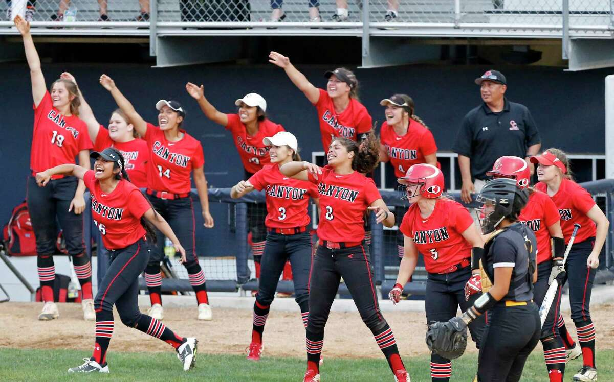 Members of the New Braunfels Canyon Cougarettes celebrate an RBI double by teammate Hunter Vestal in the eight inning against the Brennan Bears during their UIL Class 6A bidistrict game held Friday April 27, 2018 at St. Mary's University. New Braunfels Canyon won 6-4 in eight innings.