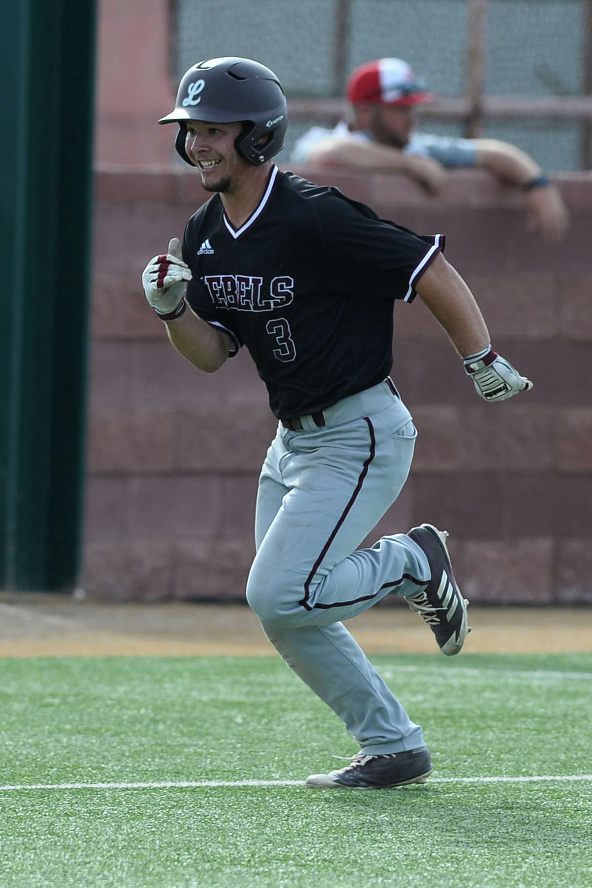 Lee's Ty Coleman runs home to score against Odessa High April 27, 2018, at Pressly Field. James Durbin/Reporter-Telegram
