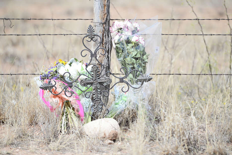 Flowers are seen April 27, 2018, near the location where two bicyclists were killed and a third was injured after being struck by a vehicle on Highway 158 the night of April 25, 2018. James Durbin/Reporter-Telegram Photo: James Durbin