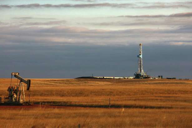 An oil drilling rig on the Bakken formation in Watford City, North Dakota. The Bakken stretches from South Dakota into Canada's province of Saskatchewan.